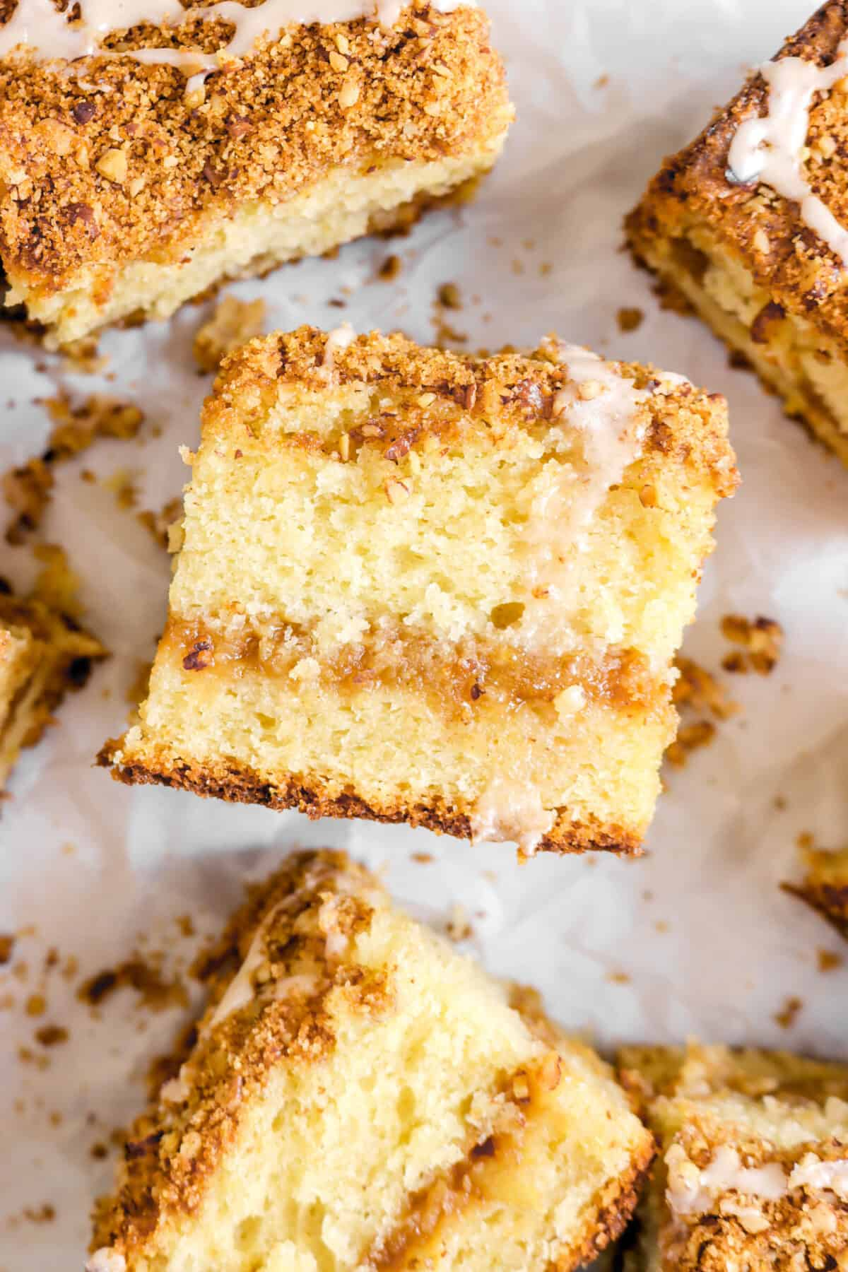 close up shot of a slice of apple pie coffee cake