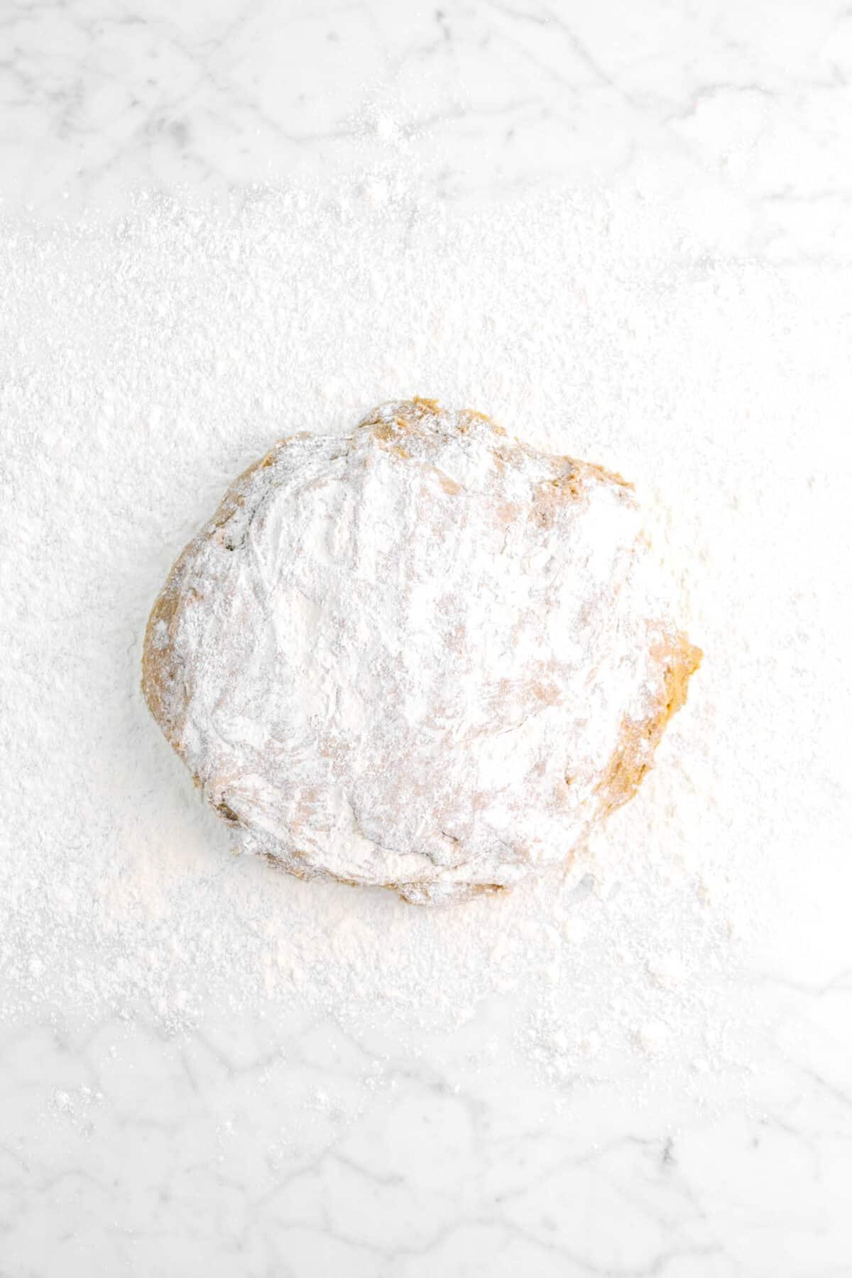 gingerbread beignet dough on floured counter