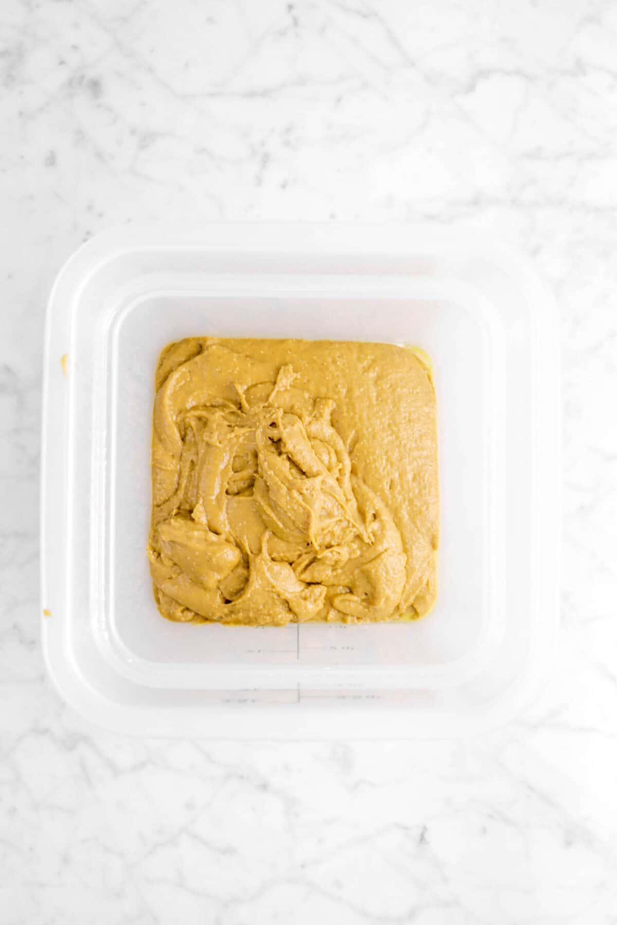 gingerbread beignet dough in a dough rising bucket
