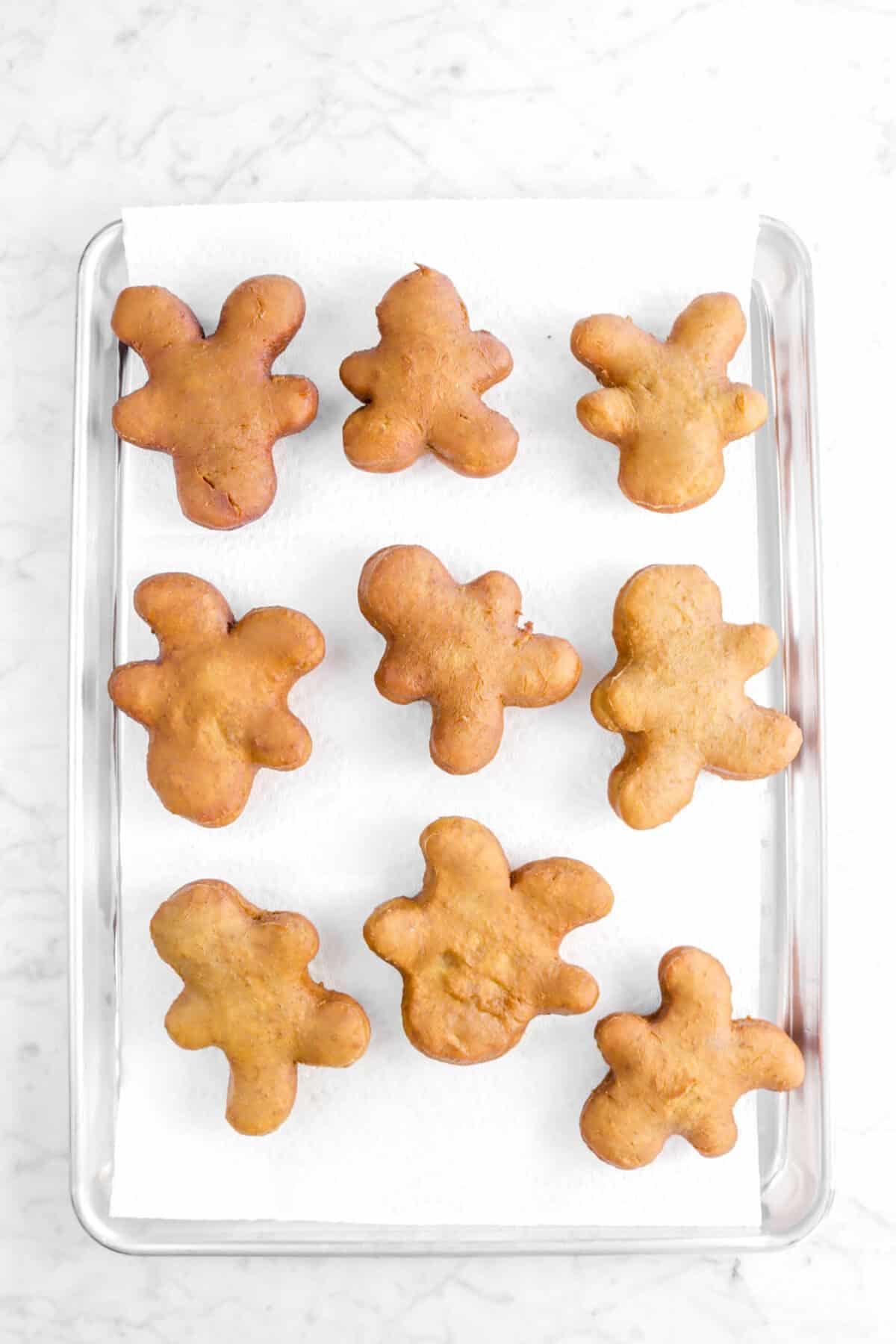 nine gingerbread beignets on lined sheet pan