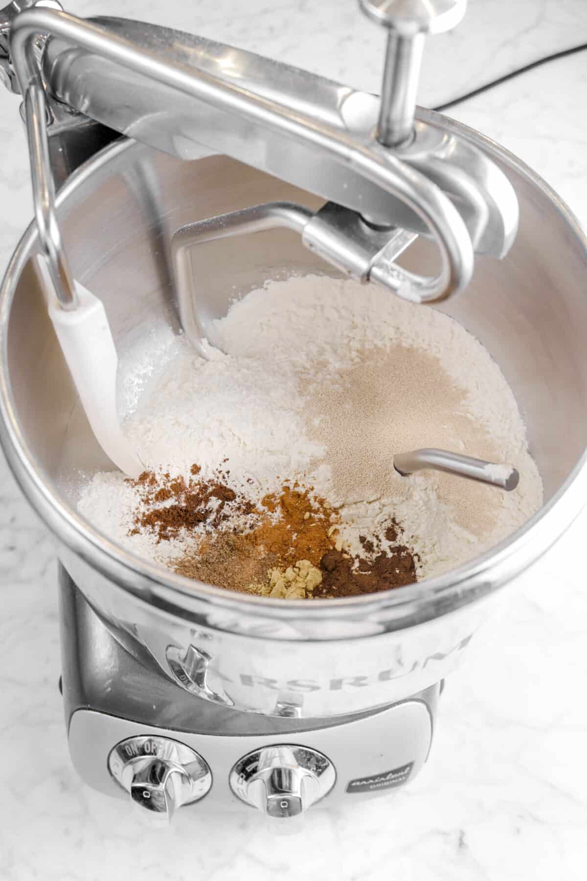 flour, spices, and yeast in a mixer