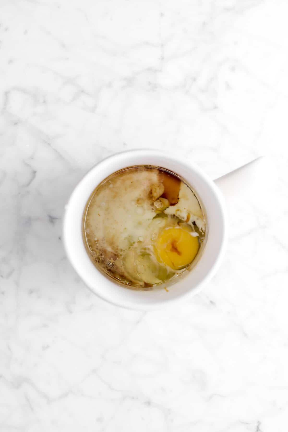 egg, milk, vegetable oil, and vanilla in white mug