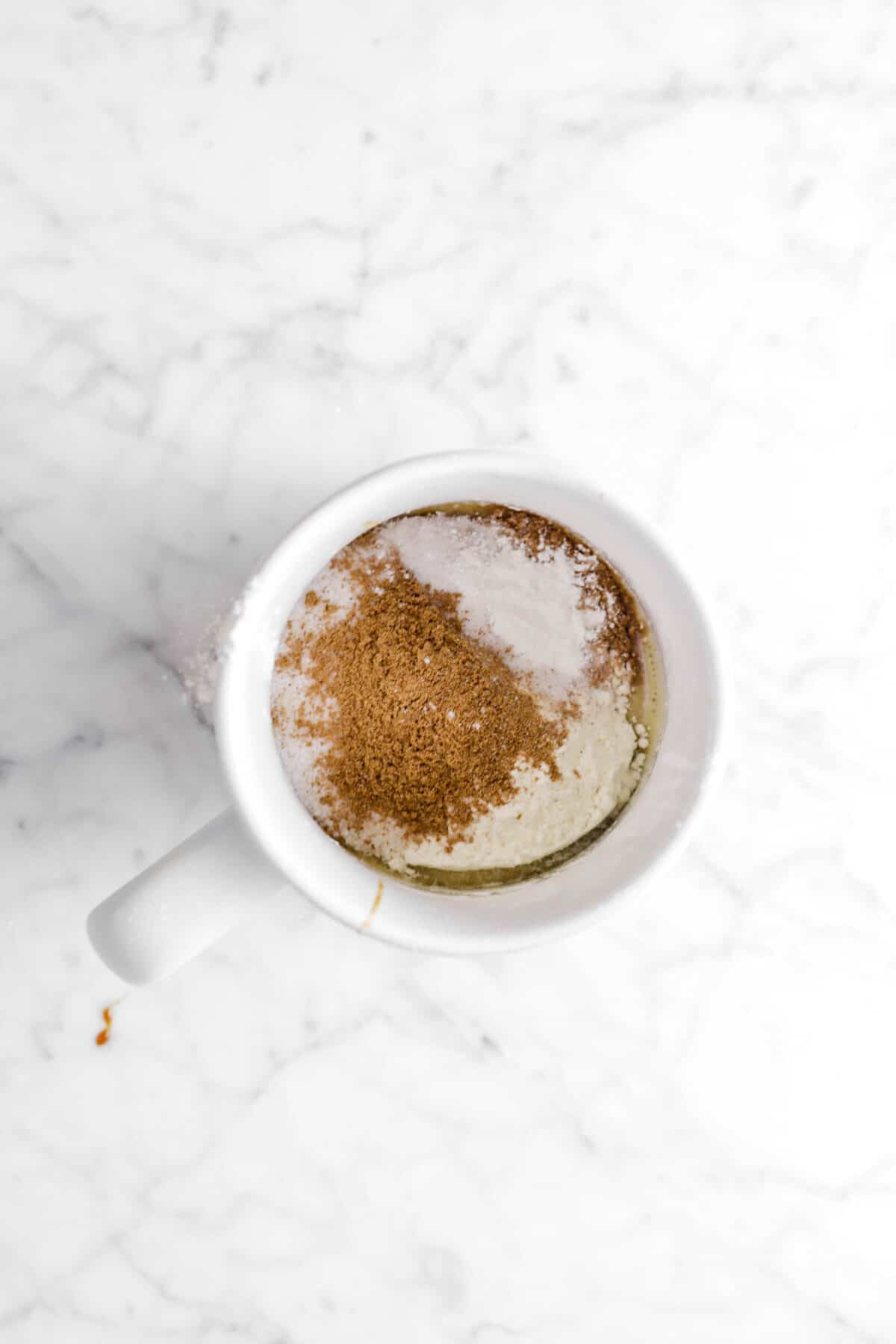flour, baking powder, salt, and spice in mug