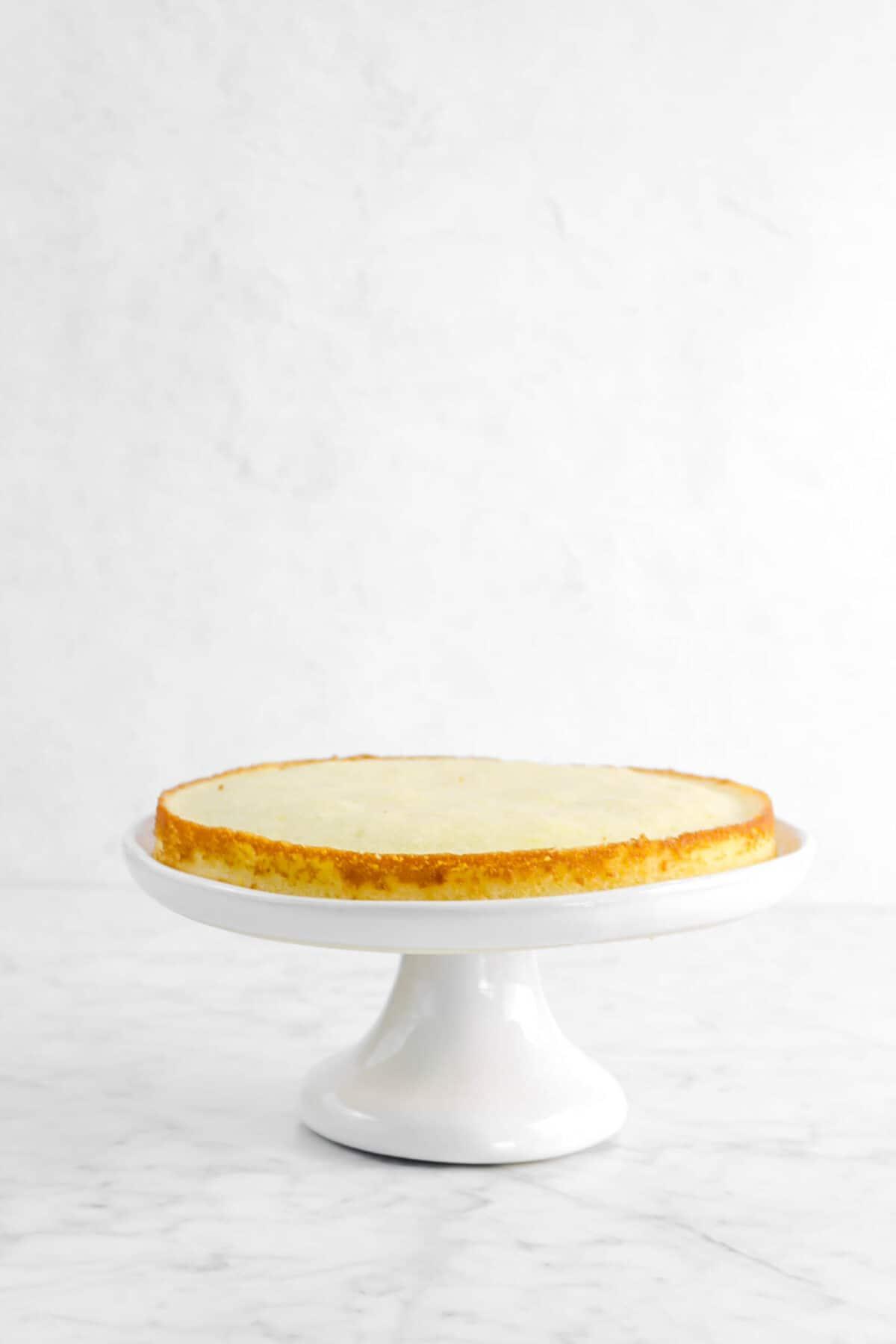 lemon cake layer on white cake stand