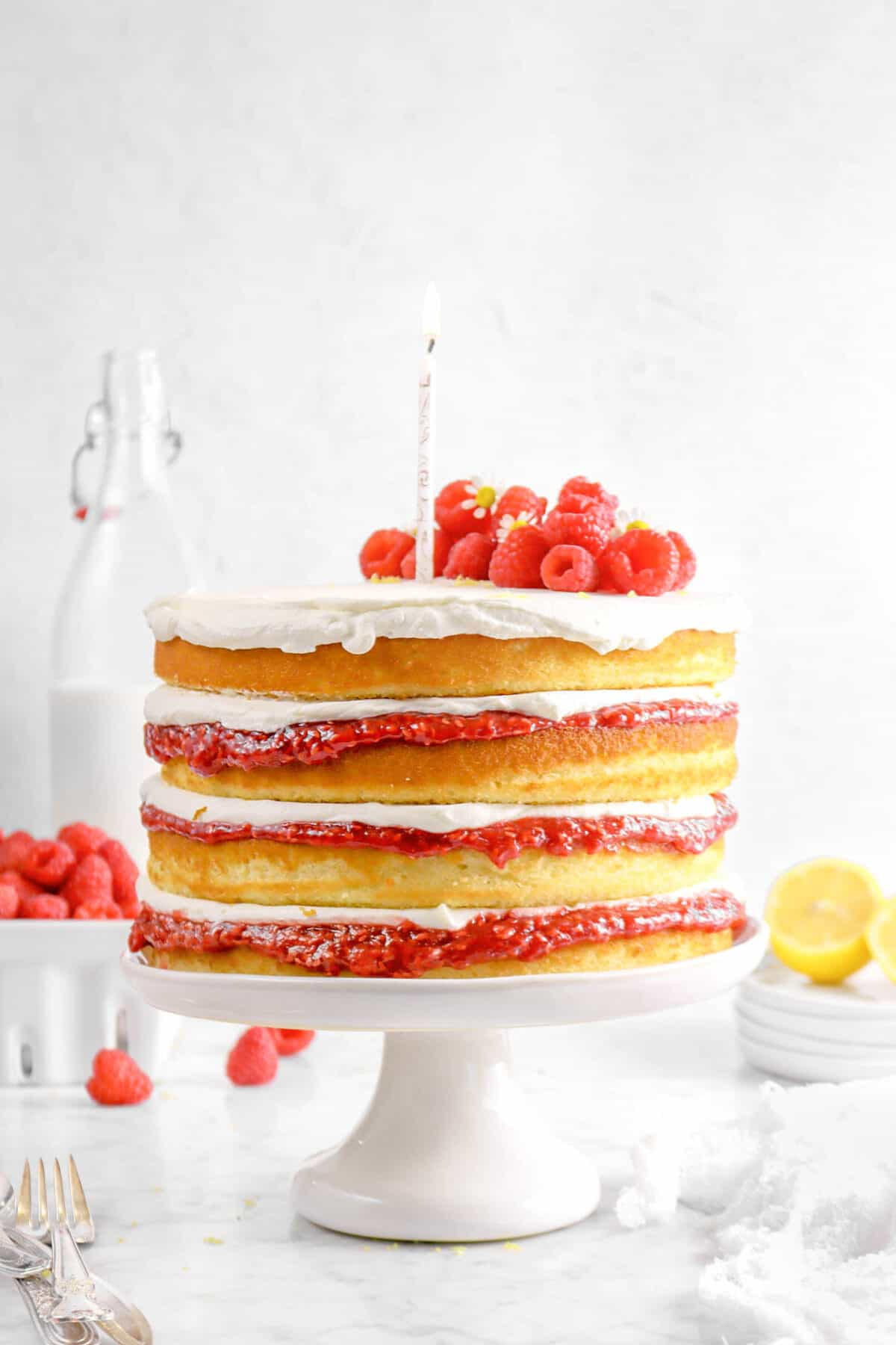 lemon cake with a candle and raspberries on top