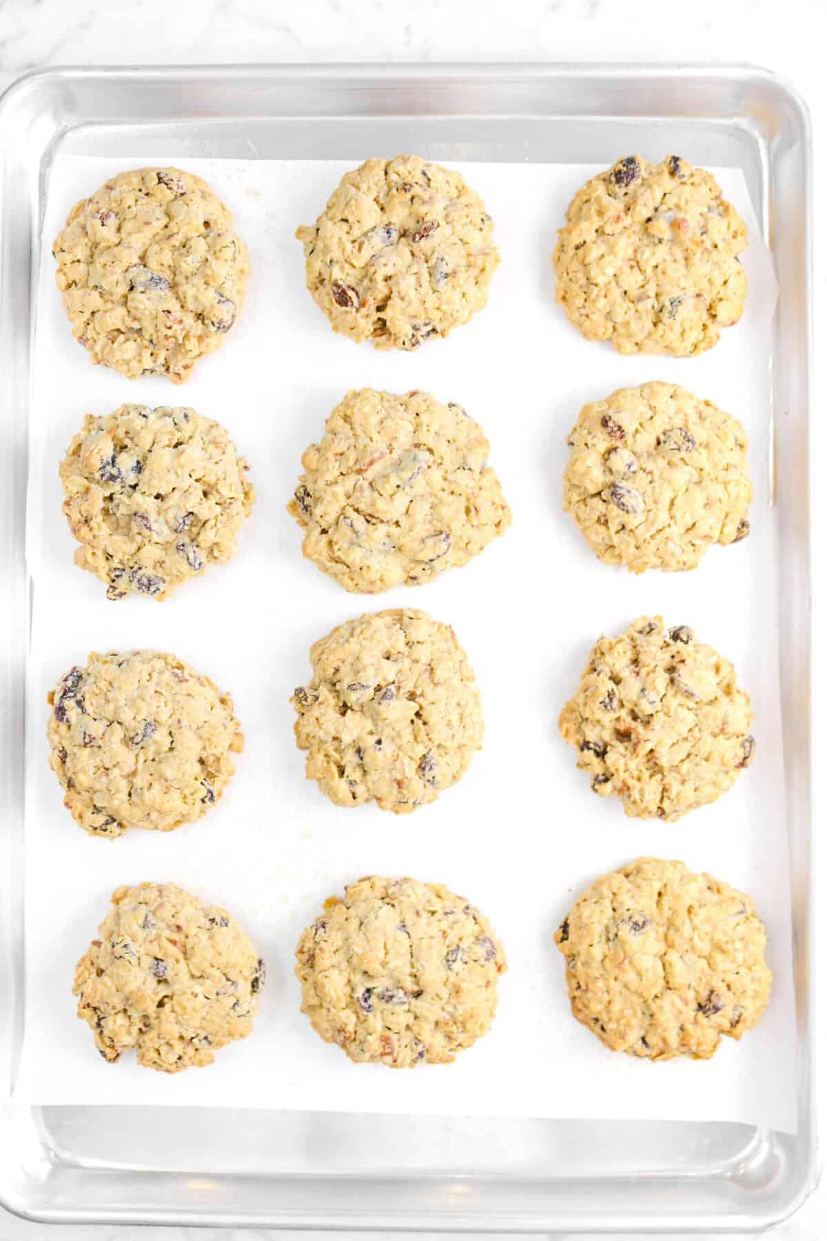 twelve cookies baked on a baking sheet