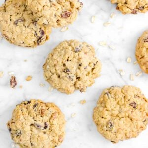eight cookies with oats on a marble counter