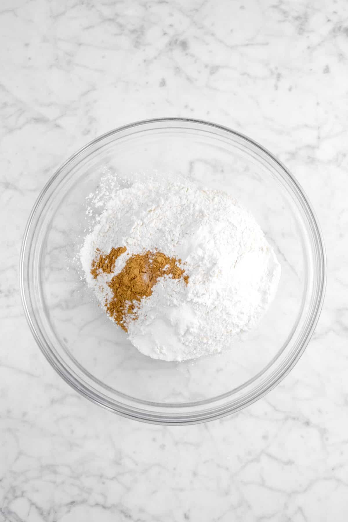 flour, salt, baking powder, baking soda, and cinnamon in a glass bowl