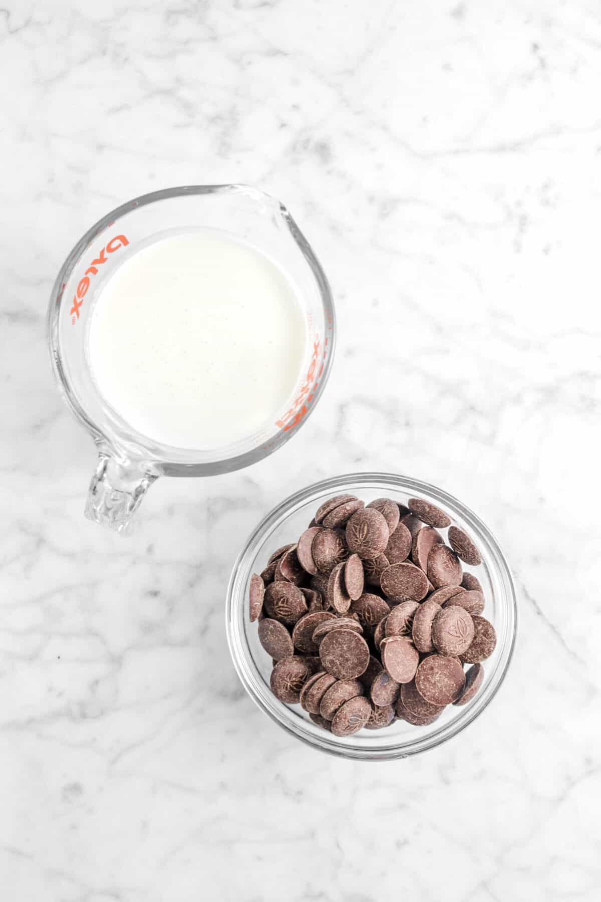 chocolate chips and cream on marble counter
