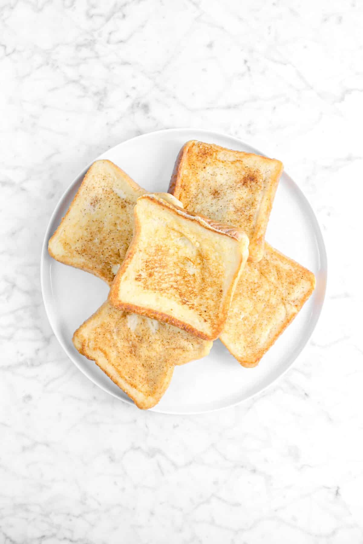 five pieces of french toast on white plate