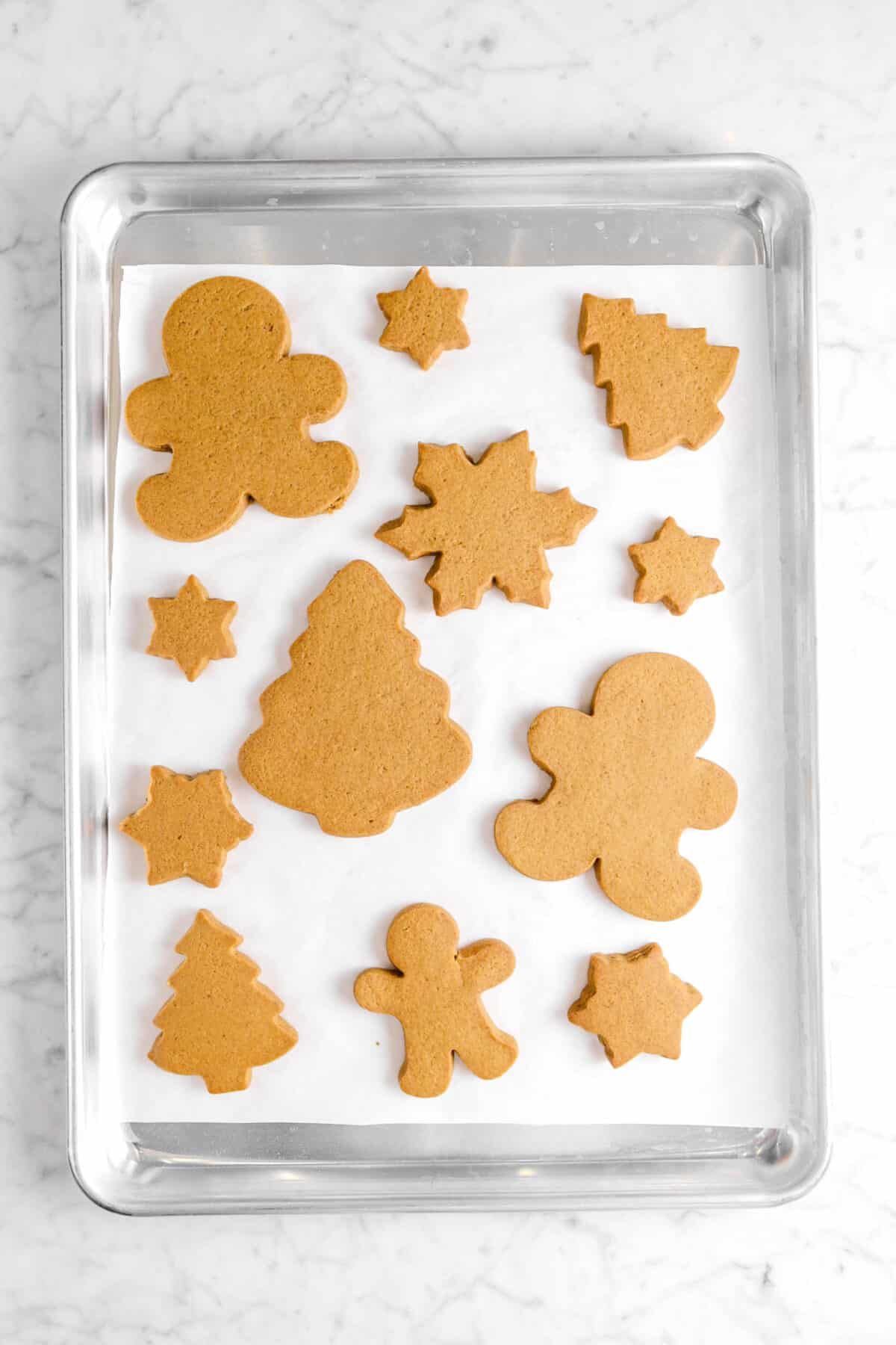 gingerbread cookies on parchment paper