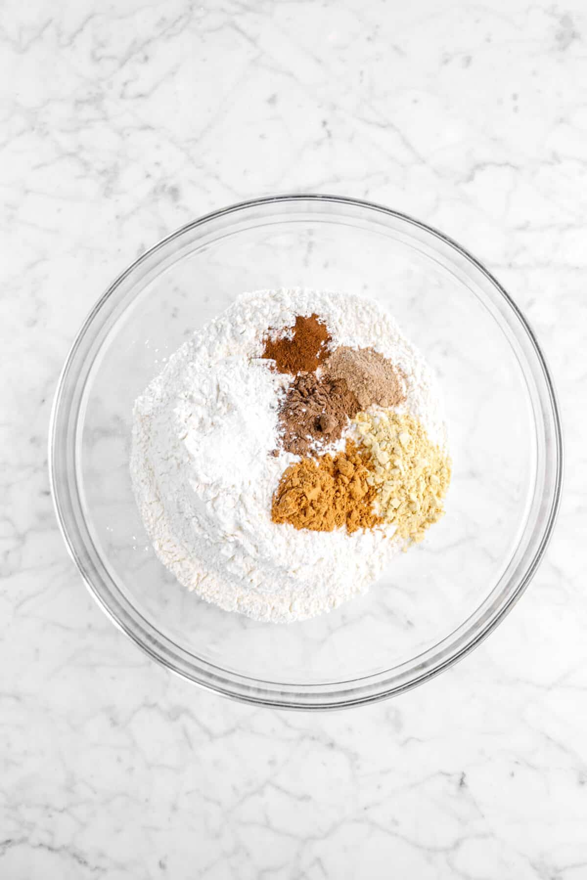 flour, spices, salt, and baking soda in glass bowl
