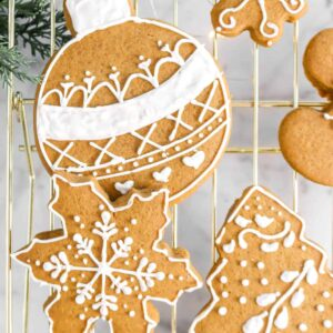overhead shot of ornament and two snowflake cookies