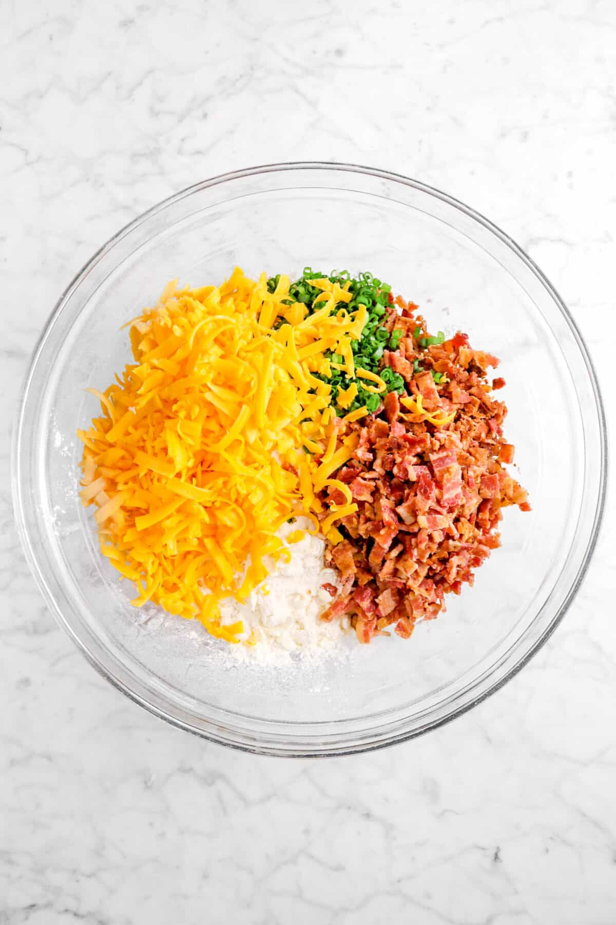 grated cheddar, chopped chives, and chopped bacon added to flour mixture