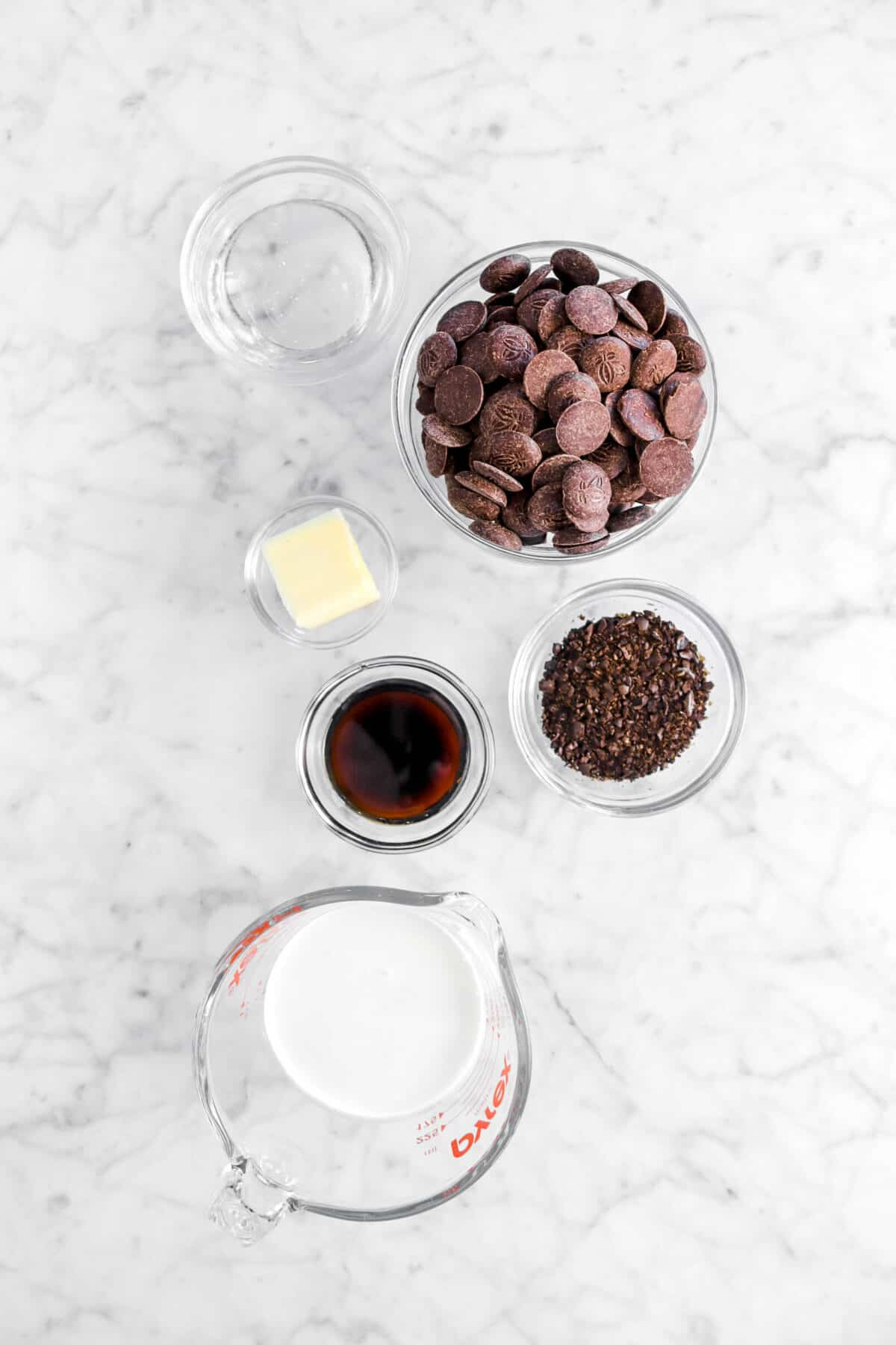 corn syrup, chocolate chips, butter, coffee liqueur, ground coffee beans, and cream