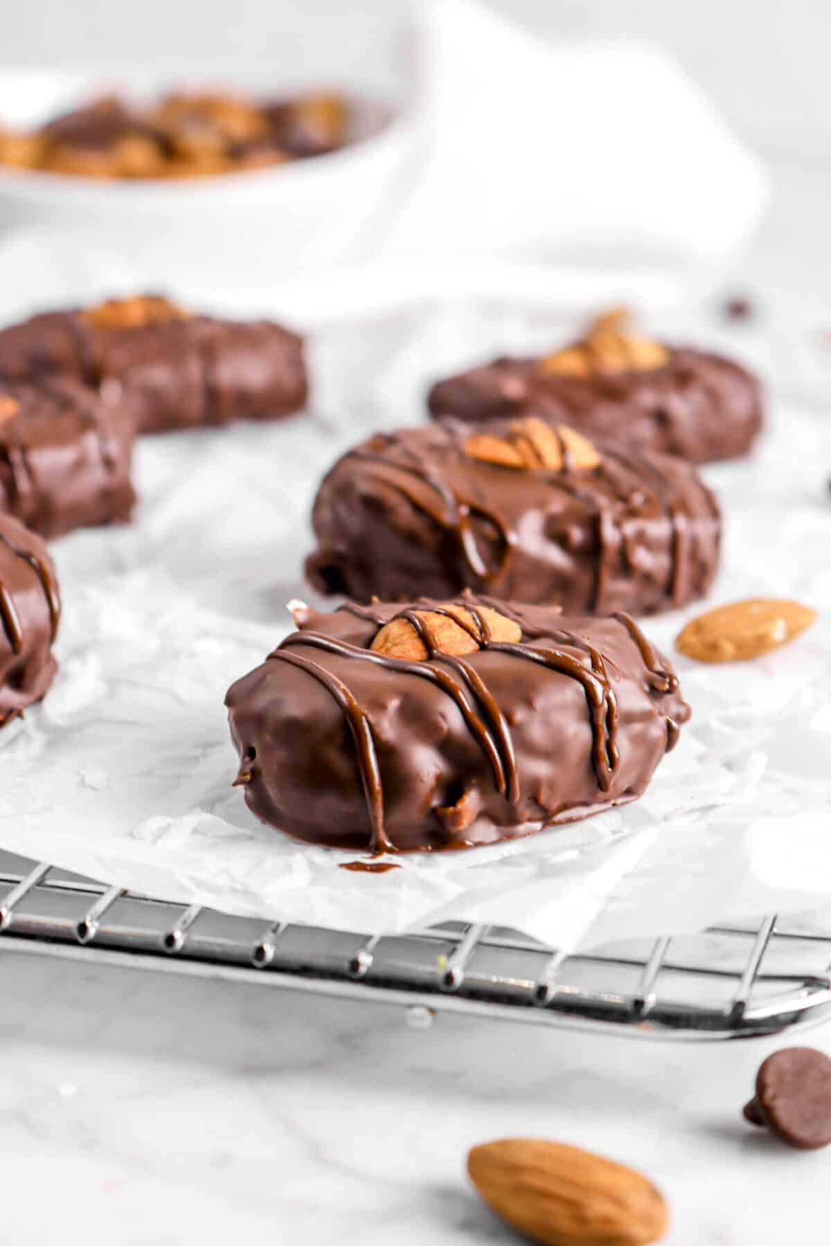 almond joys on parchment with almonds and chocolate chips