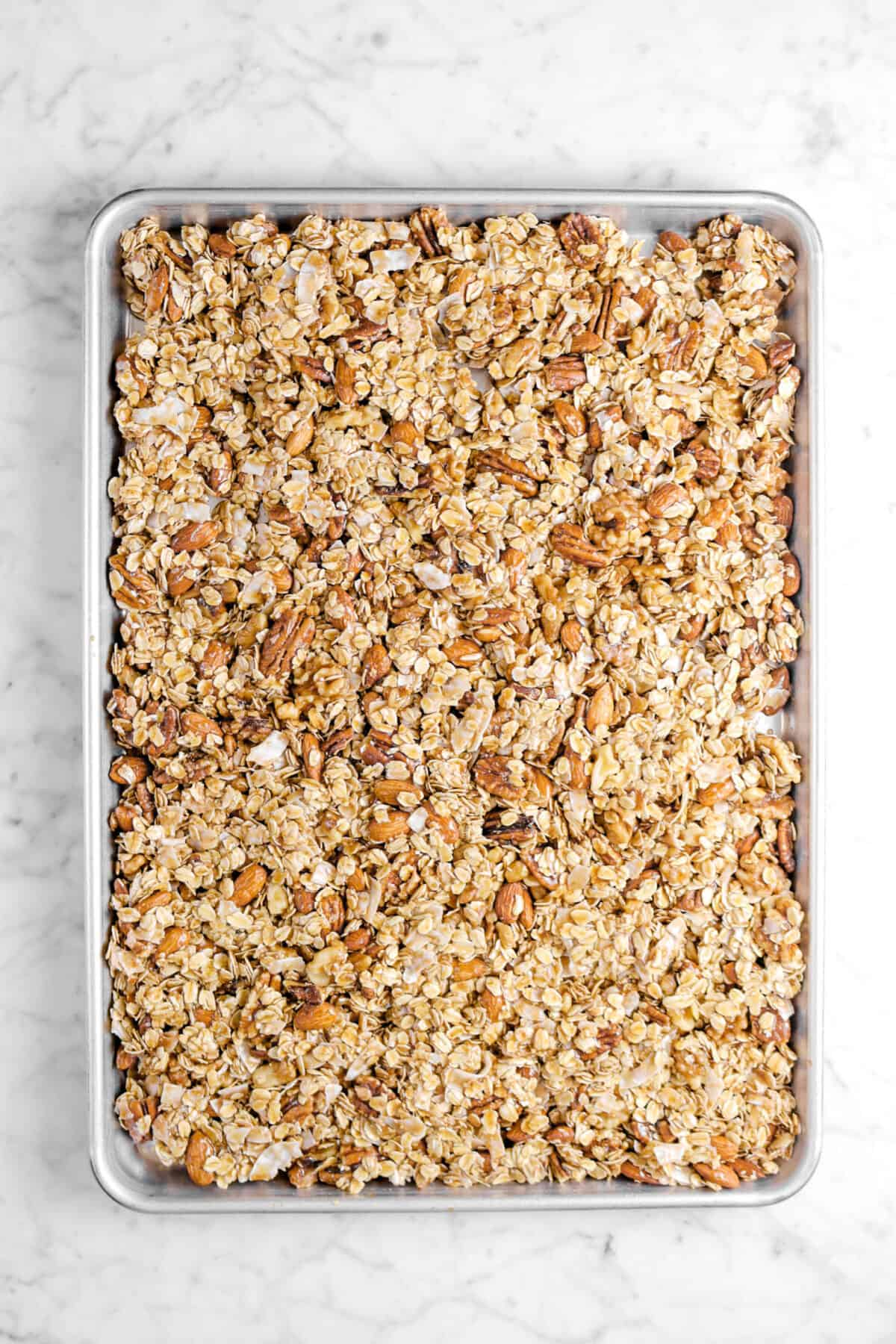 granola in sheet pan on marble counter