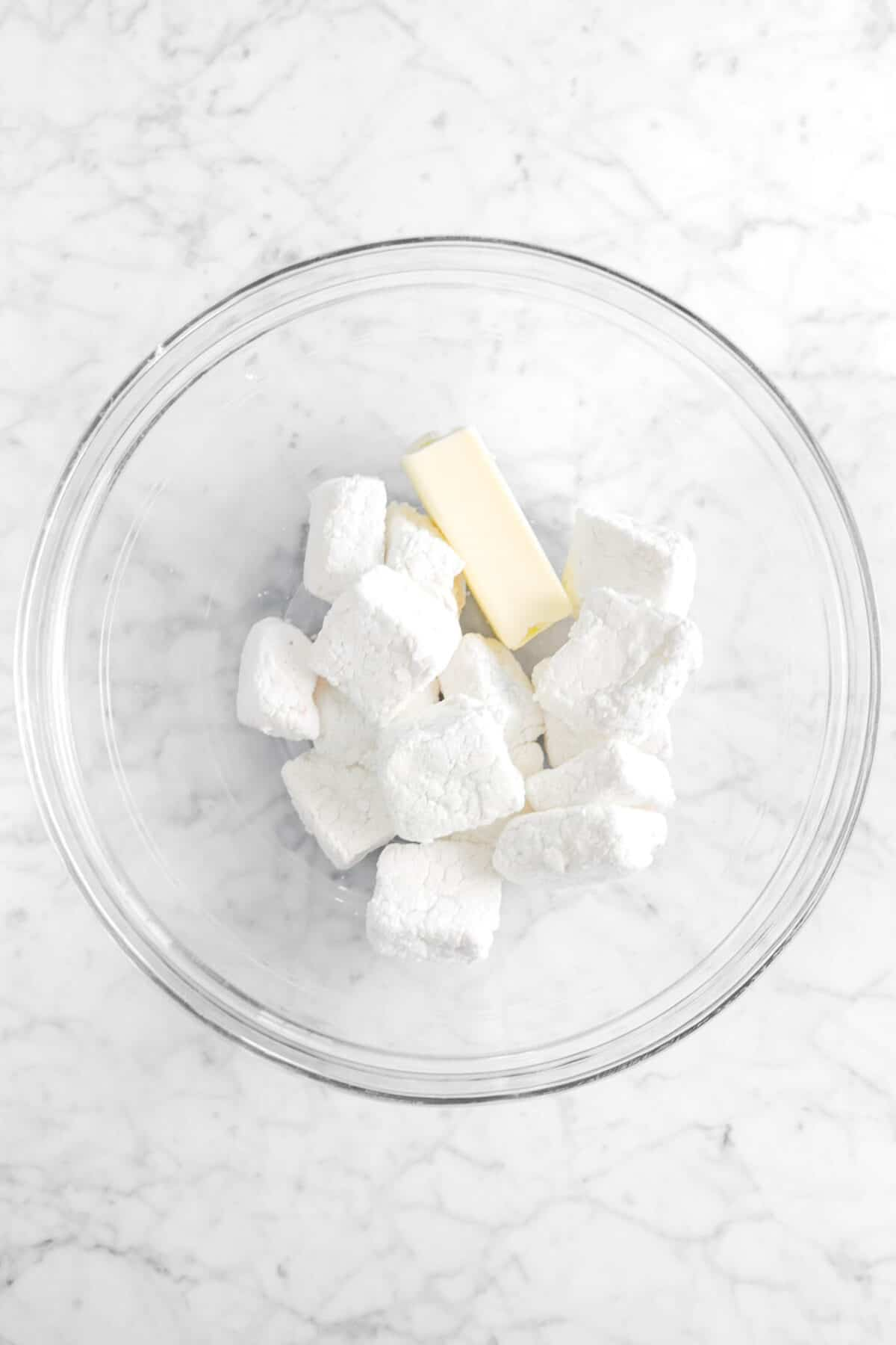 butter and marshmallows in a glass bowl