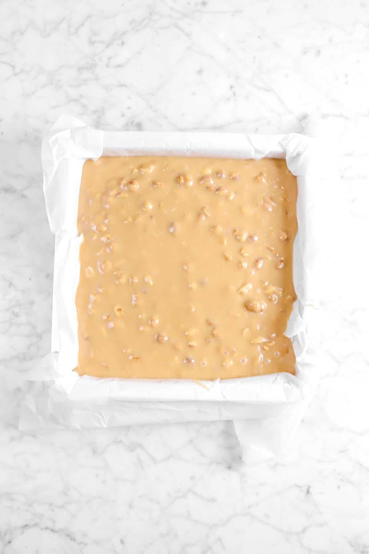 peanut caramel in square lined cake pan