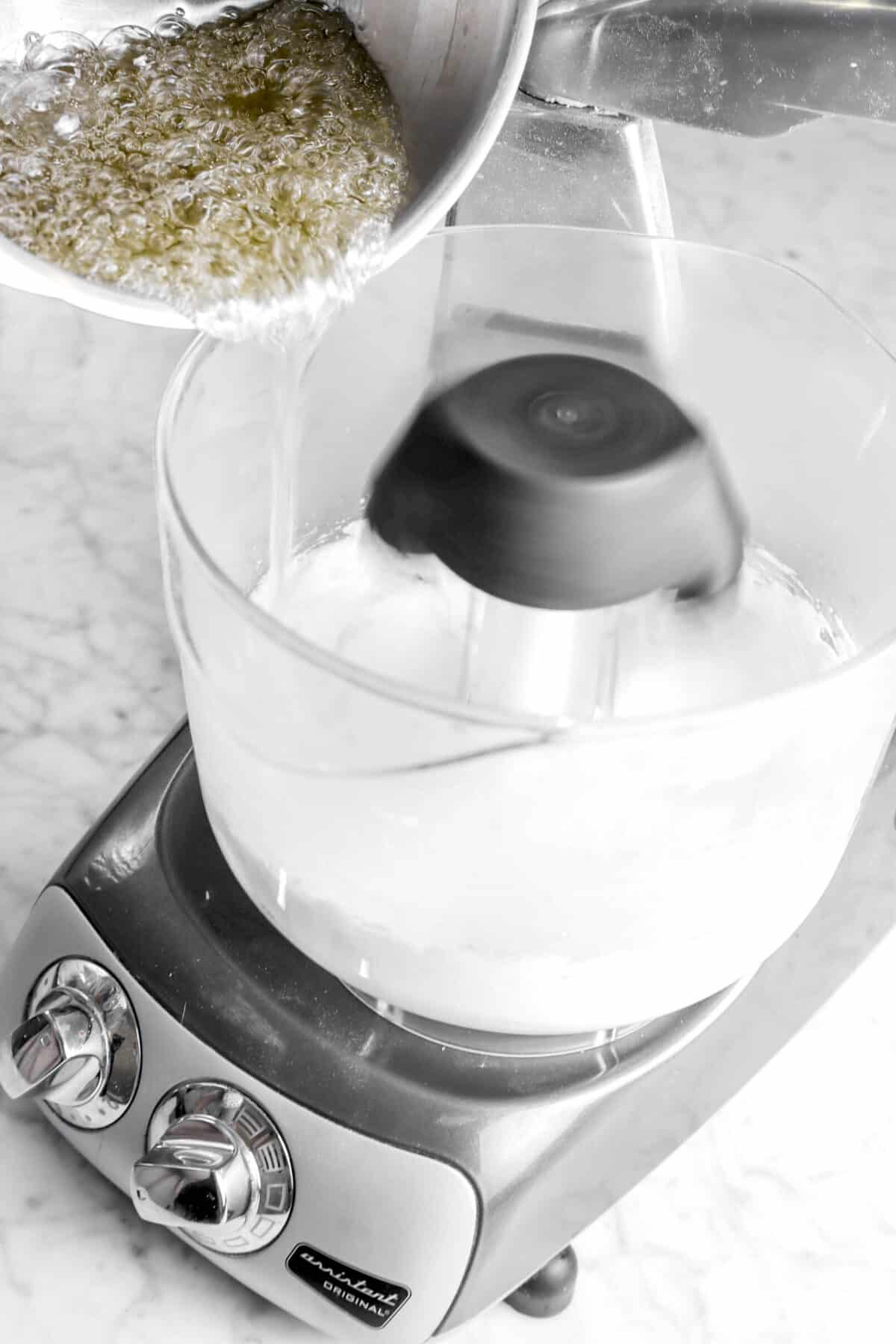 melted sugar being poured into mixer