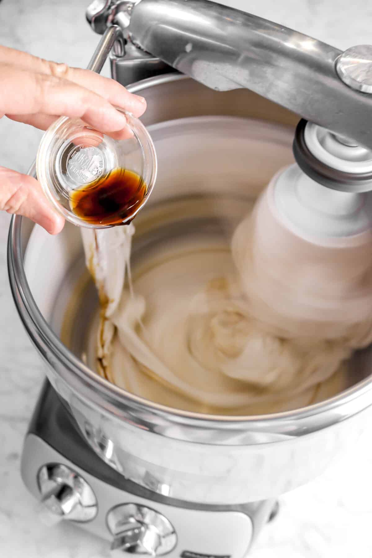vanilla being poured into egg white mixture