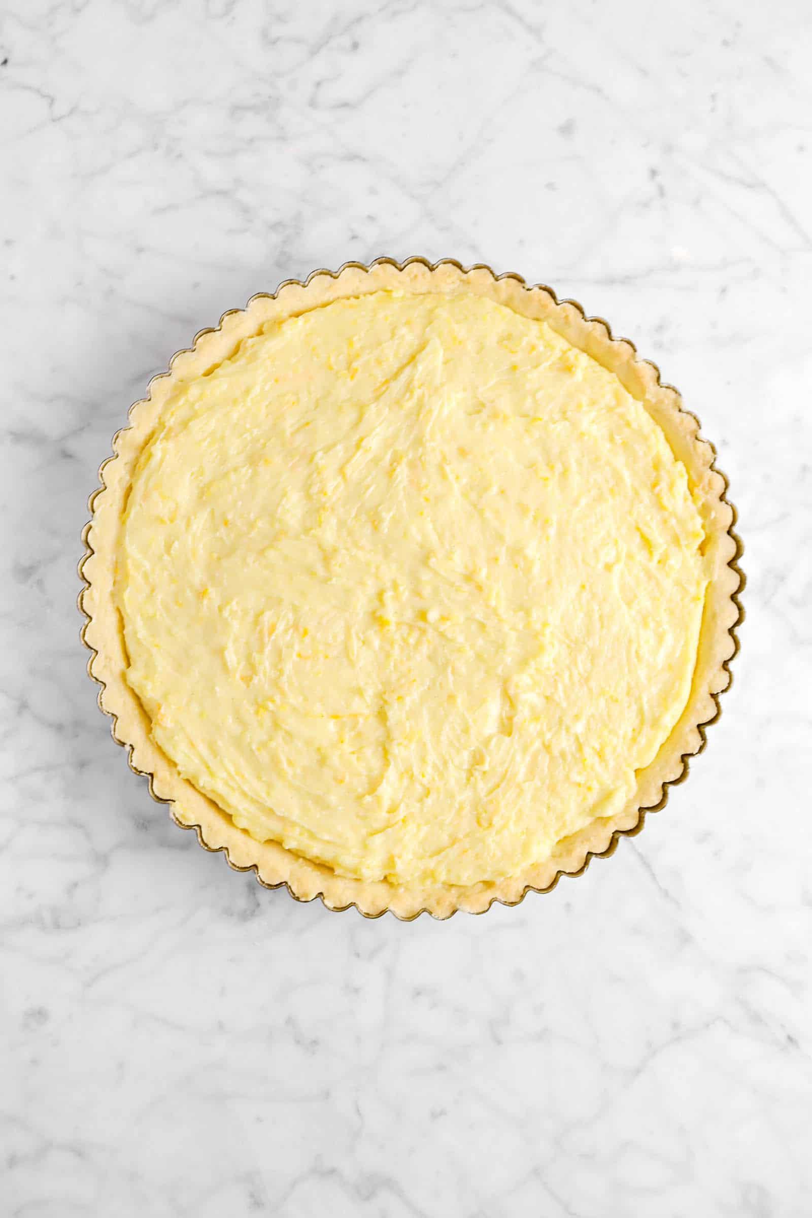 custard in tart shell on marble counter