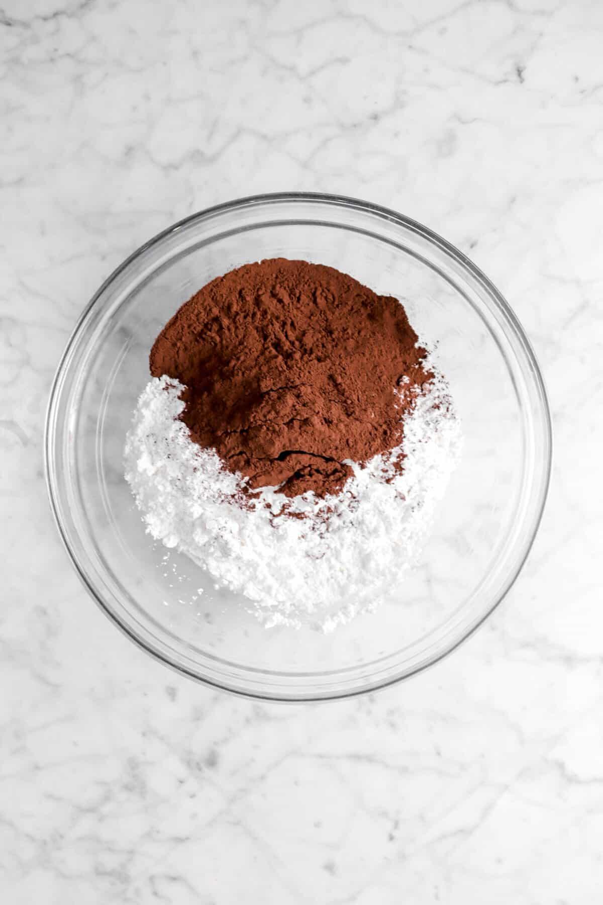 cocoa powder, powdered sugar, and milk in a glass bowl