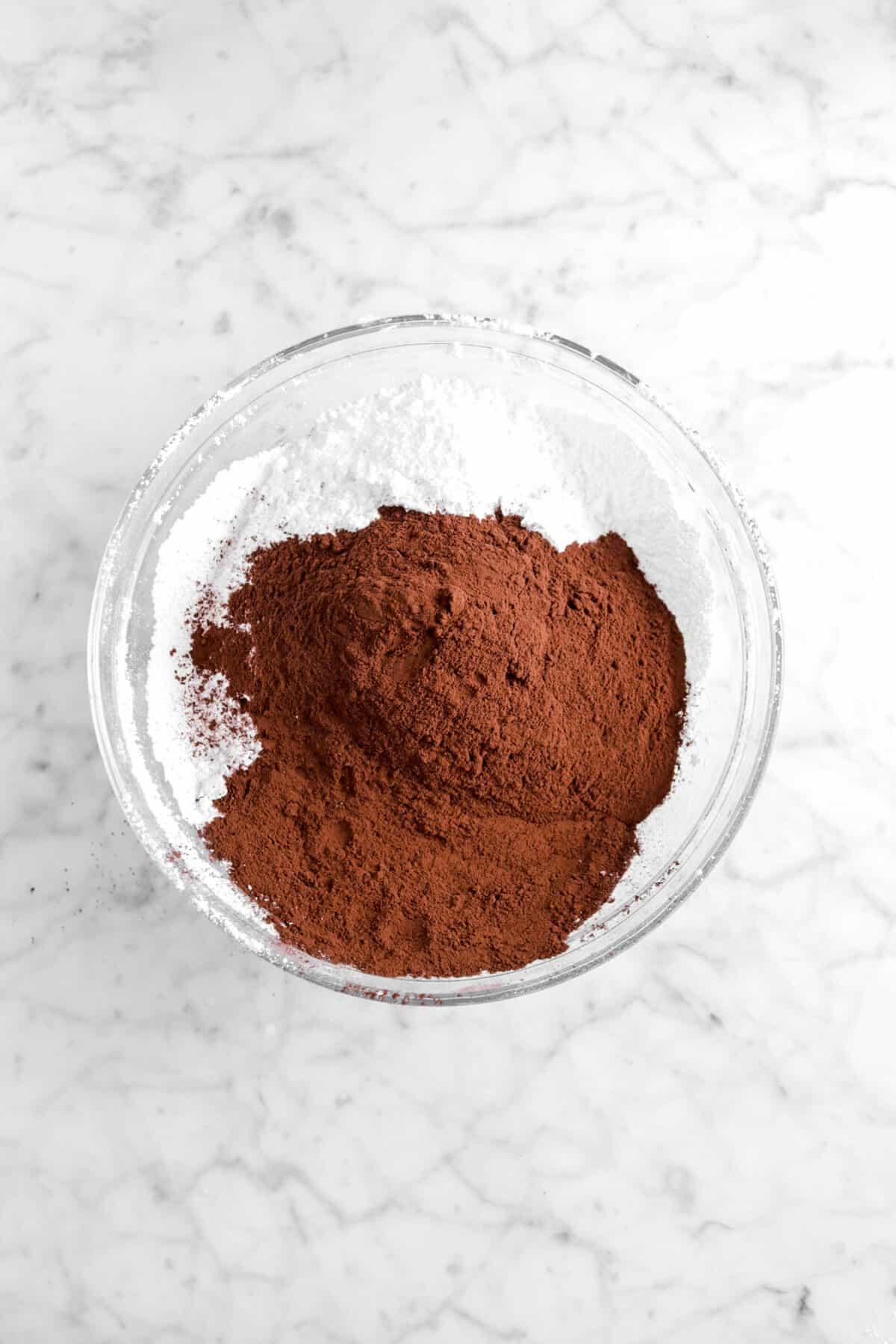 cocoa powder and powdered sugar in glass bowl