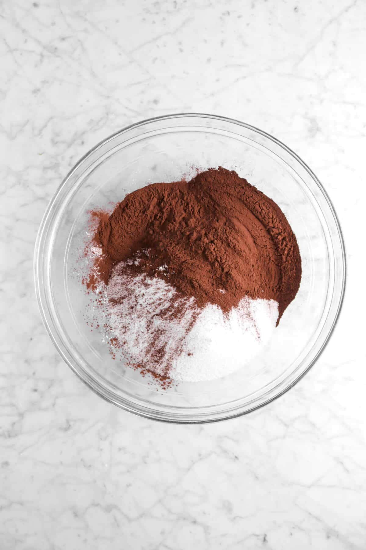 sugar, flour, and cocoa powder in glass bowl