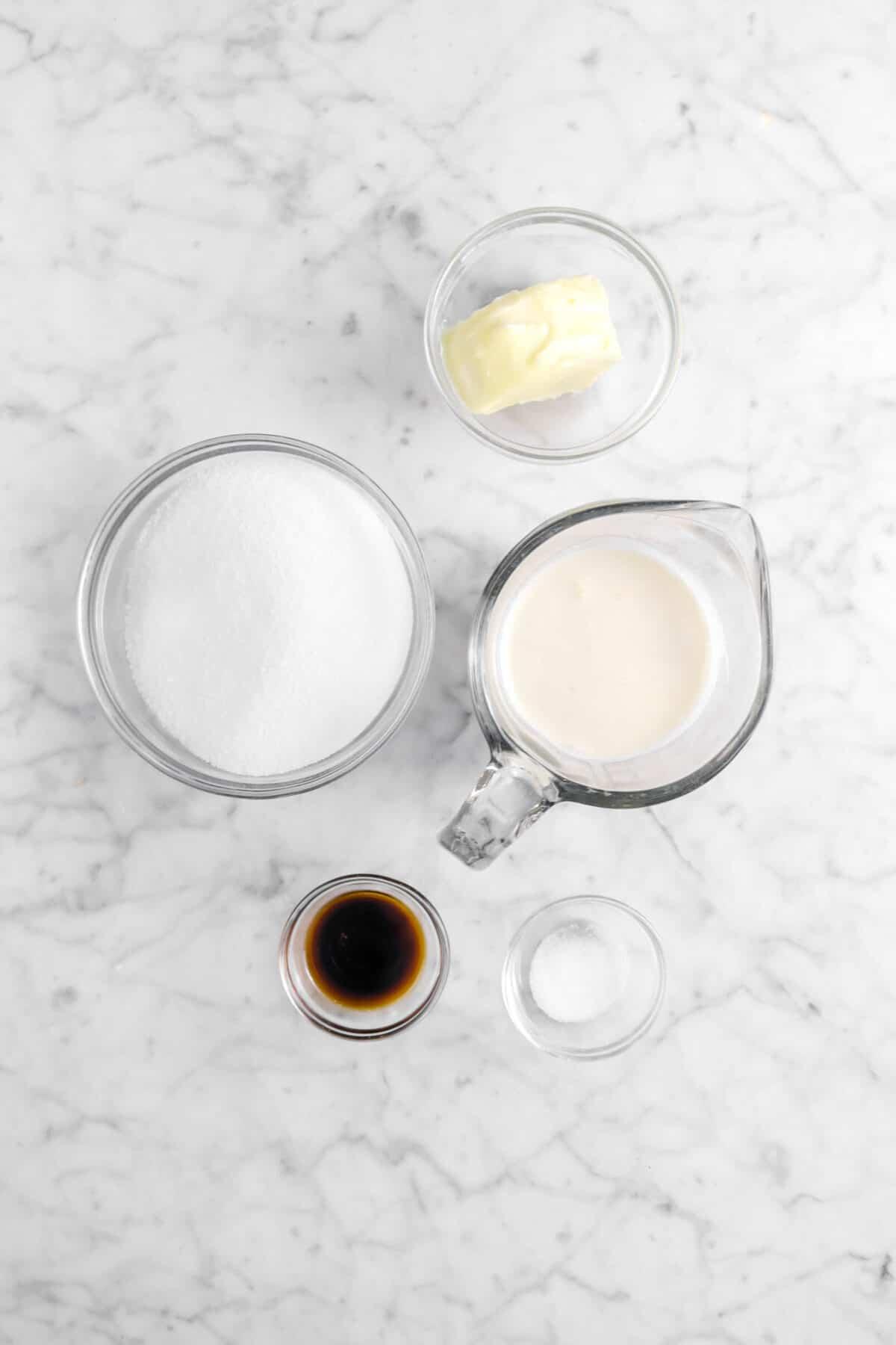 butter, sugar, cream, vanilla, and salt on marble counter