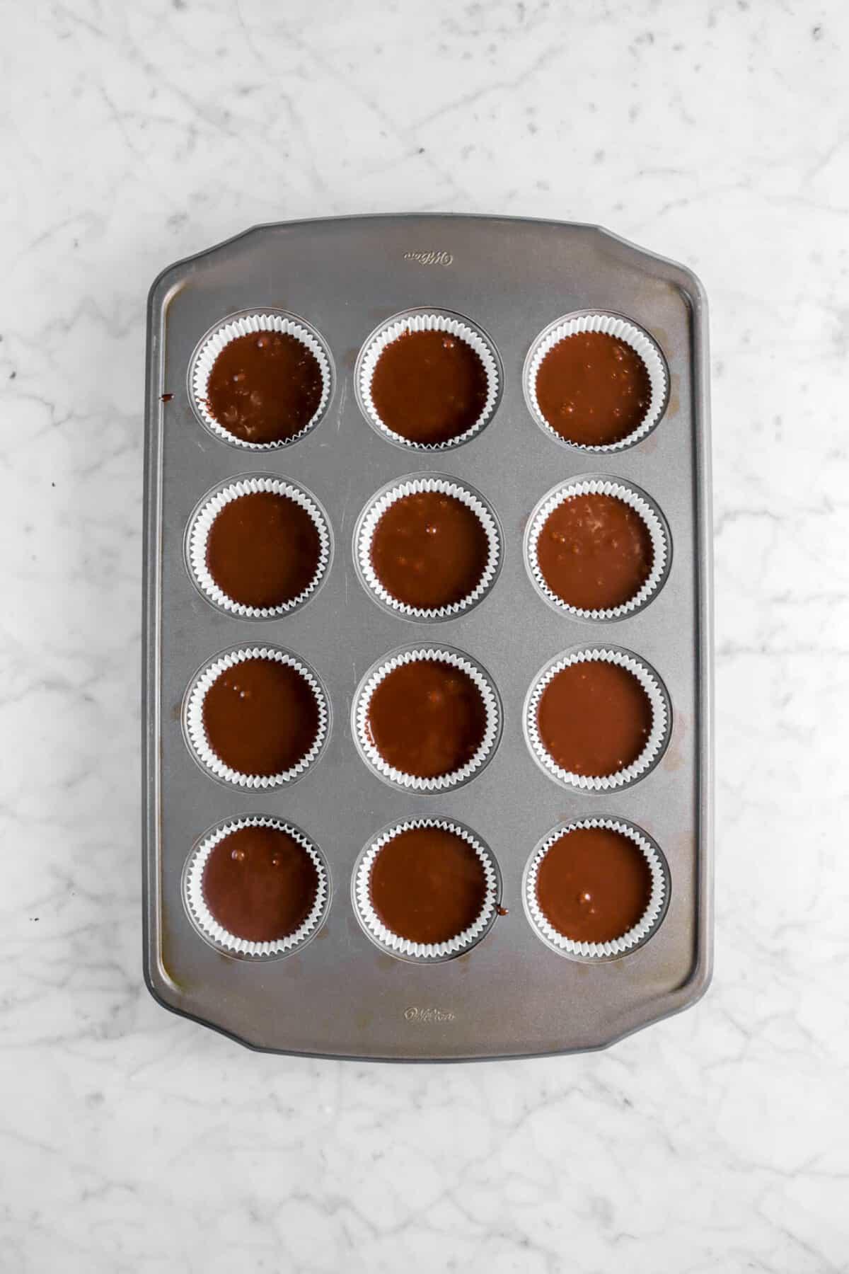 cupcake batter in lined cupcake pan