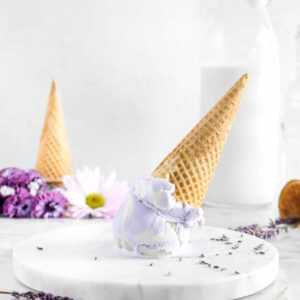 ice cream upside down on marble plate with flowers and glass of milk