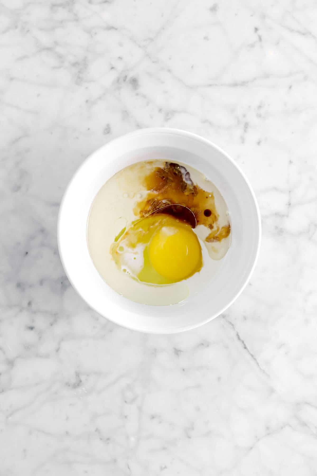 egg, oil, milk, and vanilla in white ramekin