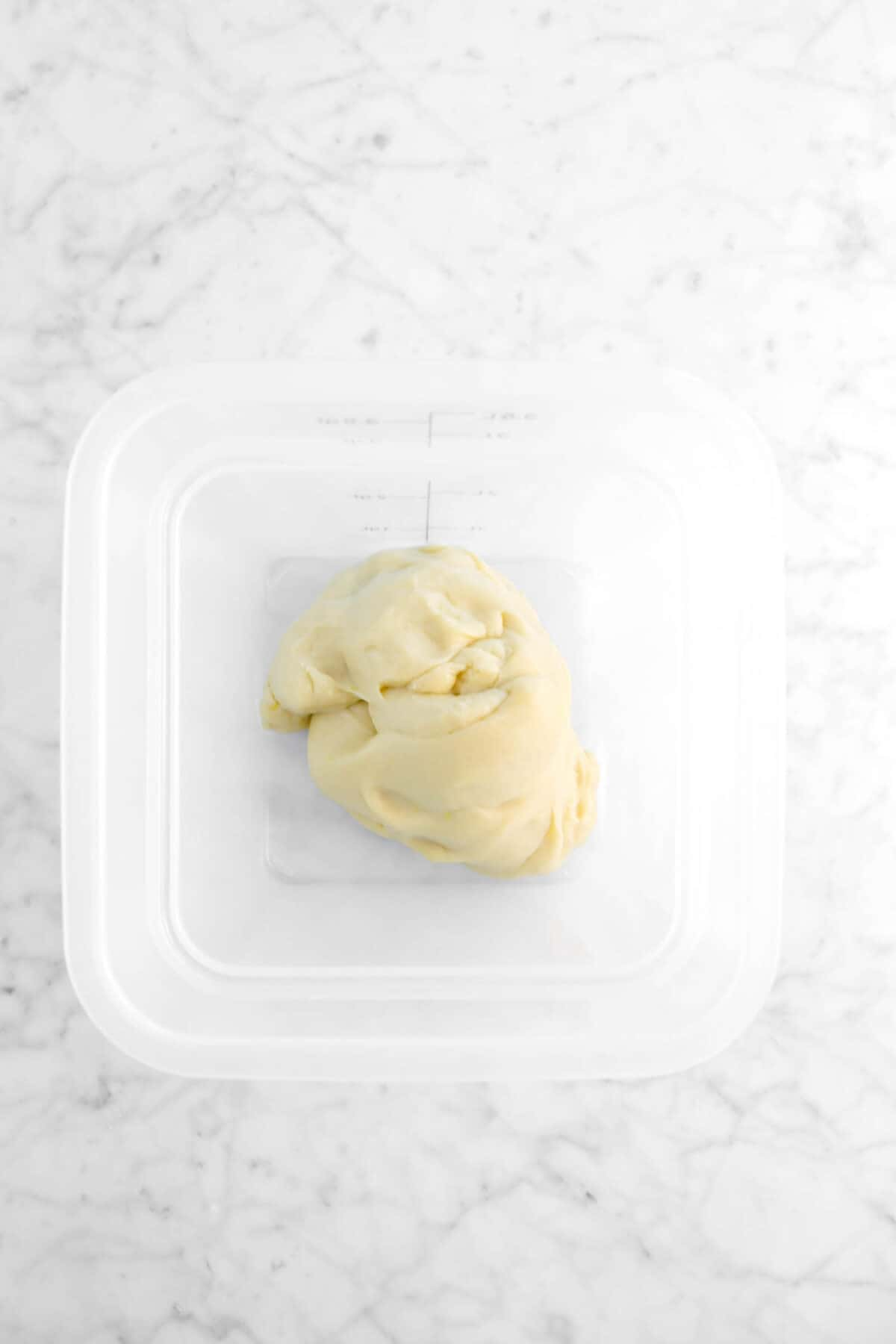 sweet dough in plastic container