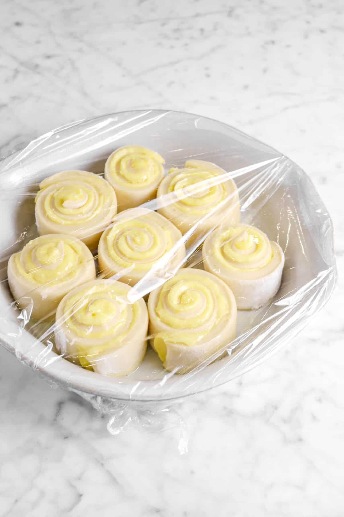 lemon rolls covered with plastic wrap