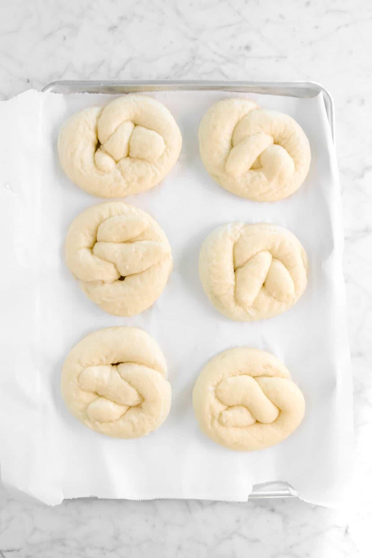 boiled pretzels on parchment paper