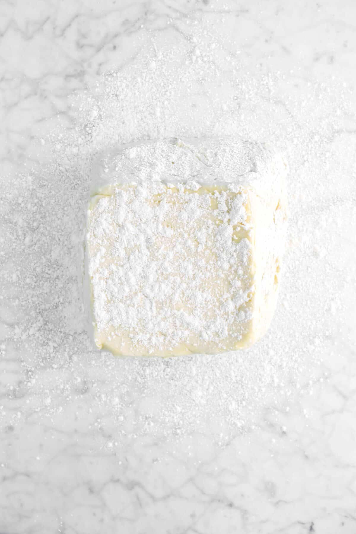 dough on floured surface with flour on top