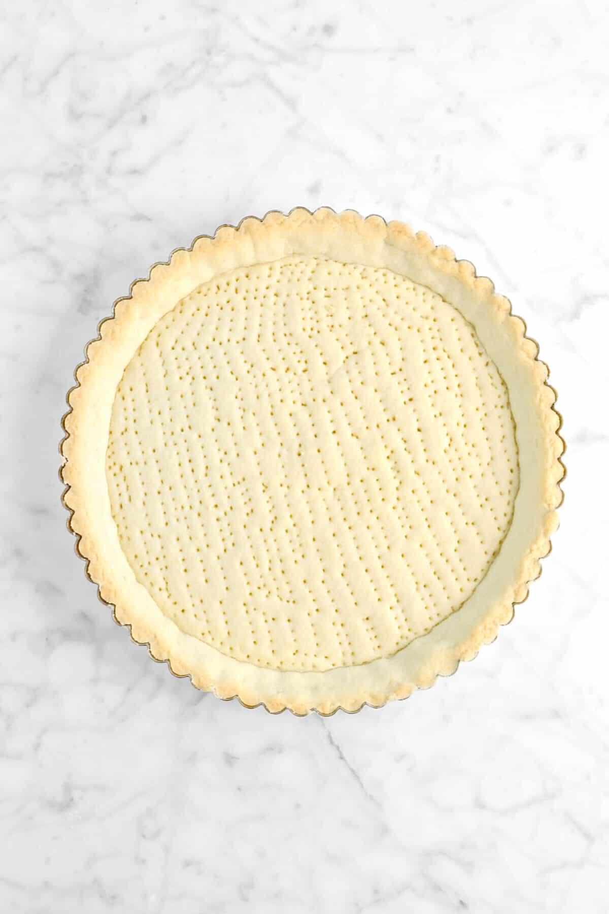 baked tart shell on marble counter