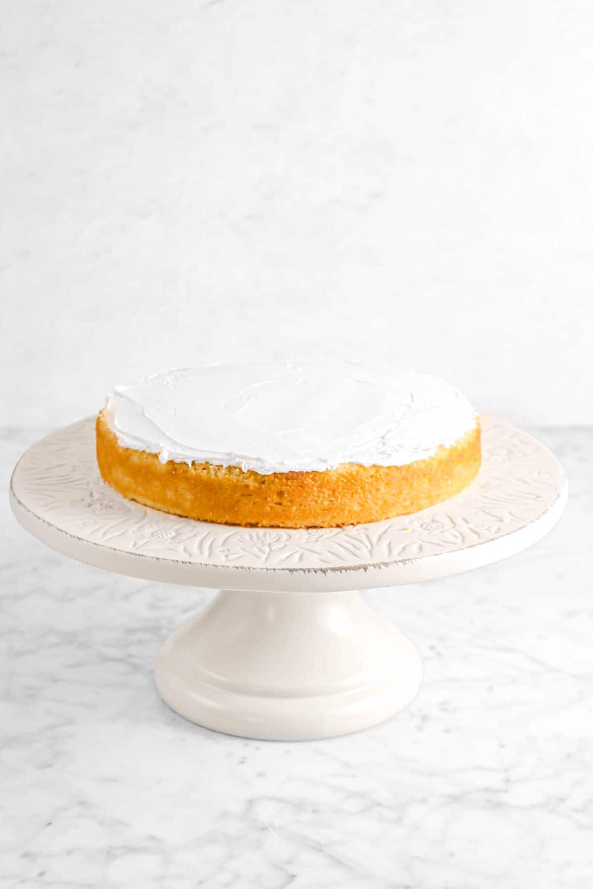 buttercream spread on cake layer