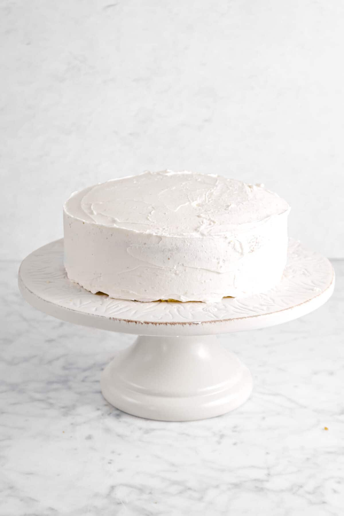 two layer cake on white cake stand