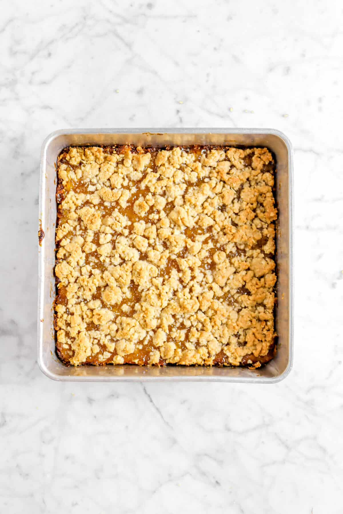 baked peach crumble in square pan