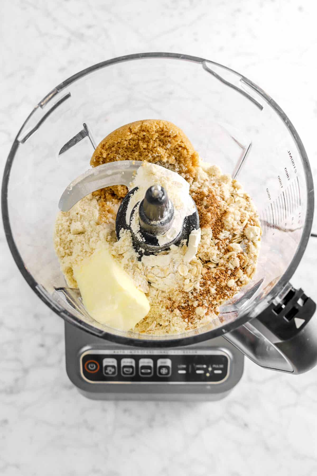 brown sugar, nutmeg, flour, almond flour, oats, and butter in food processor