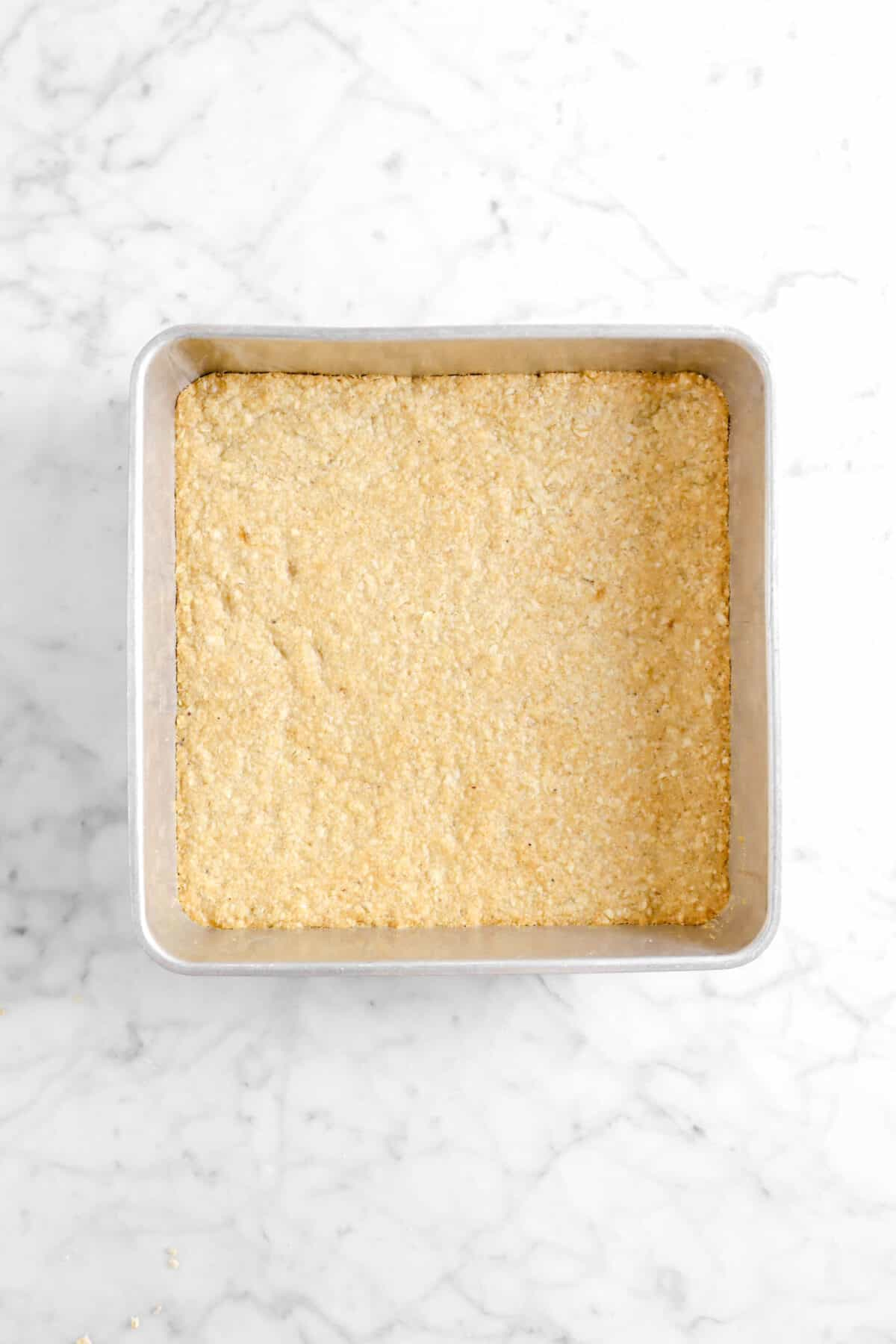 baked crumble bar base in square pan