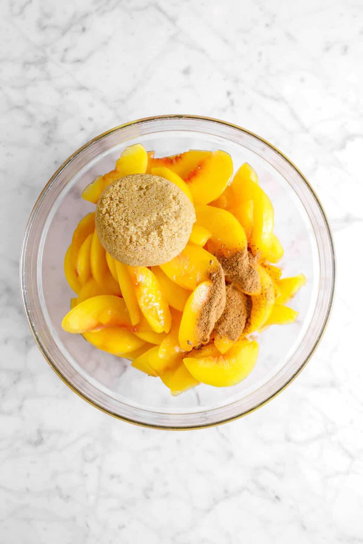 peach slices, ground nutmeg, and brown sugar in a bowl
