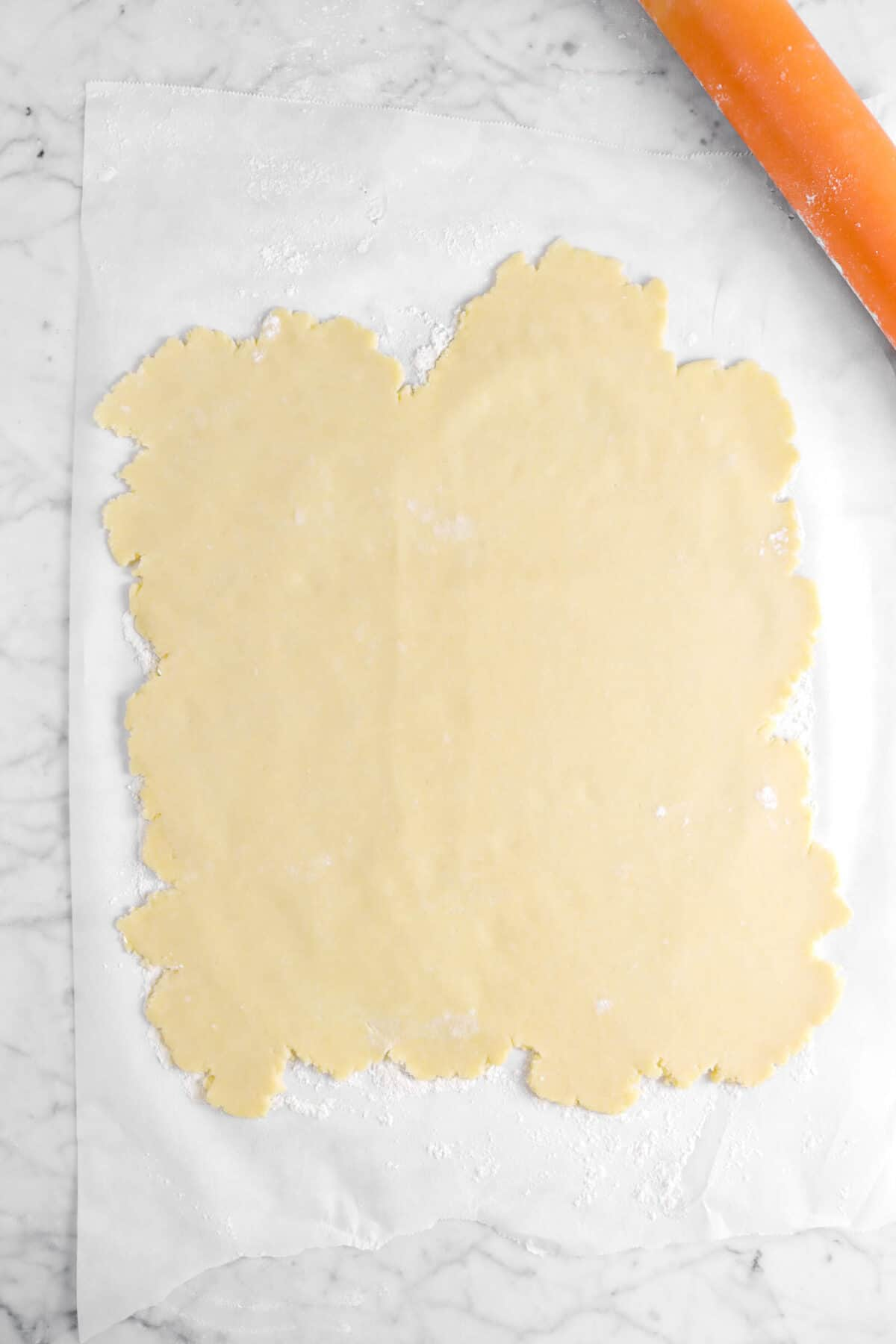 pie dough rolled into a rough square