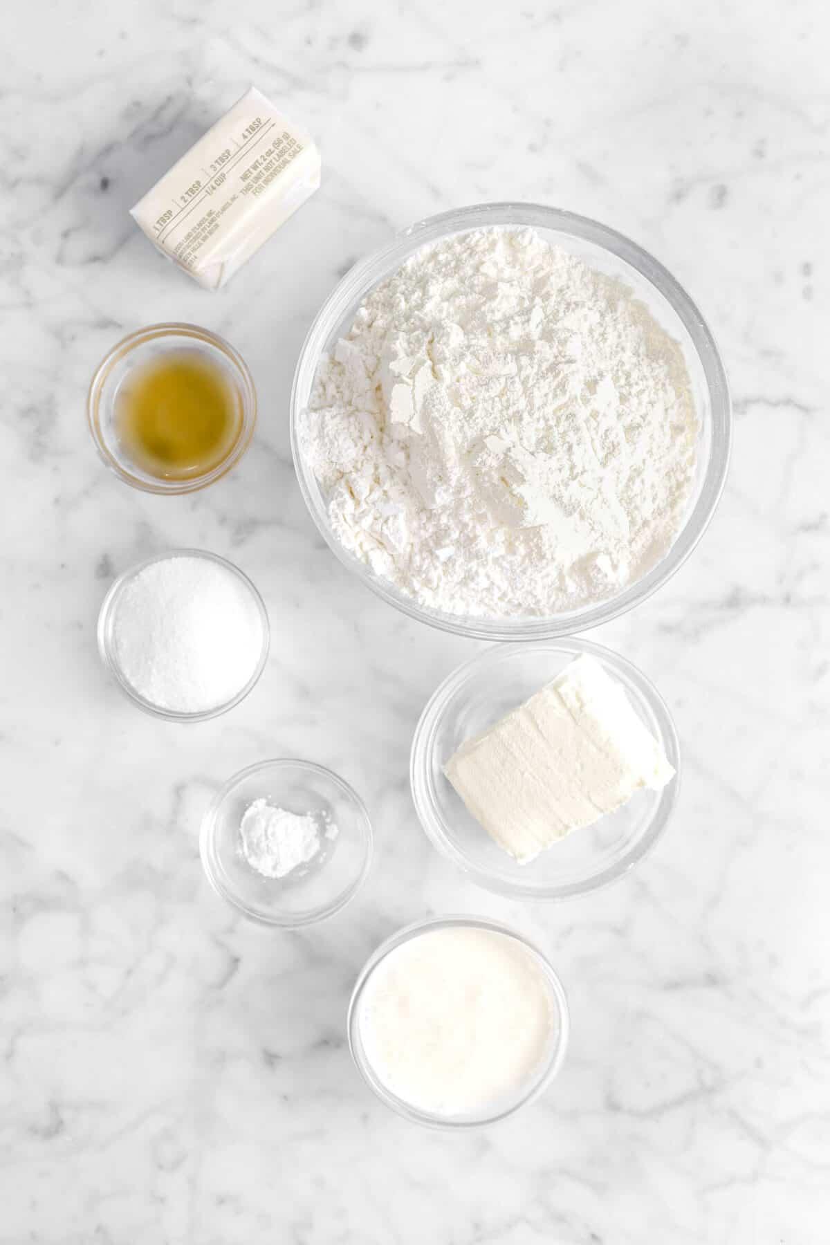 butter, apple cider vinegar, flour, sugar, baking powder, cream cheese, and heavy cream in glass bowls