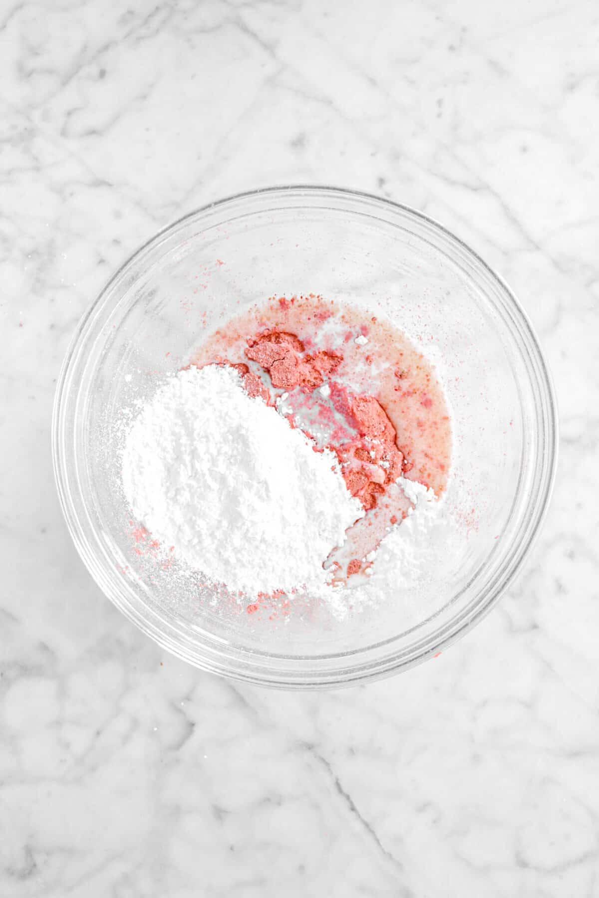 strawberry powder, milk, and powdered sugar in glass bowl