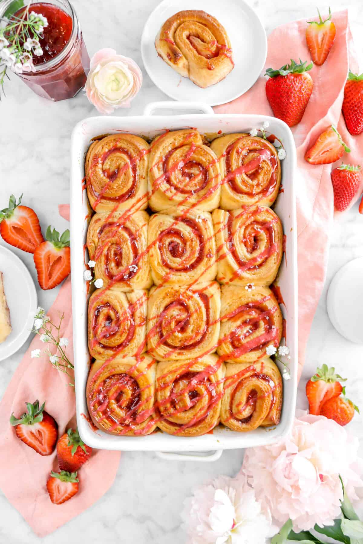 strawberry rolls on pink napkin with strawberries and flowers