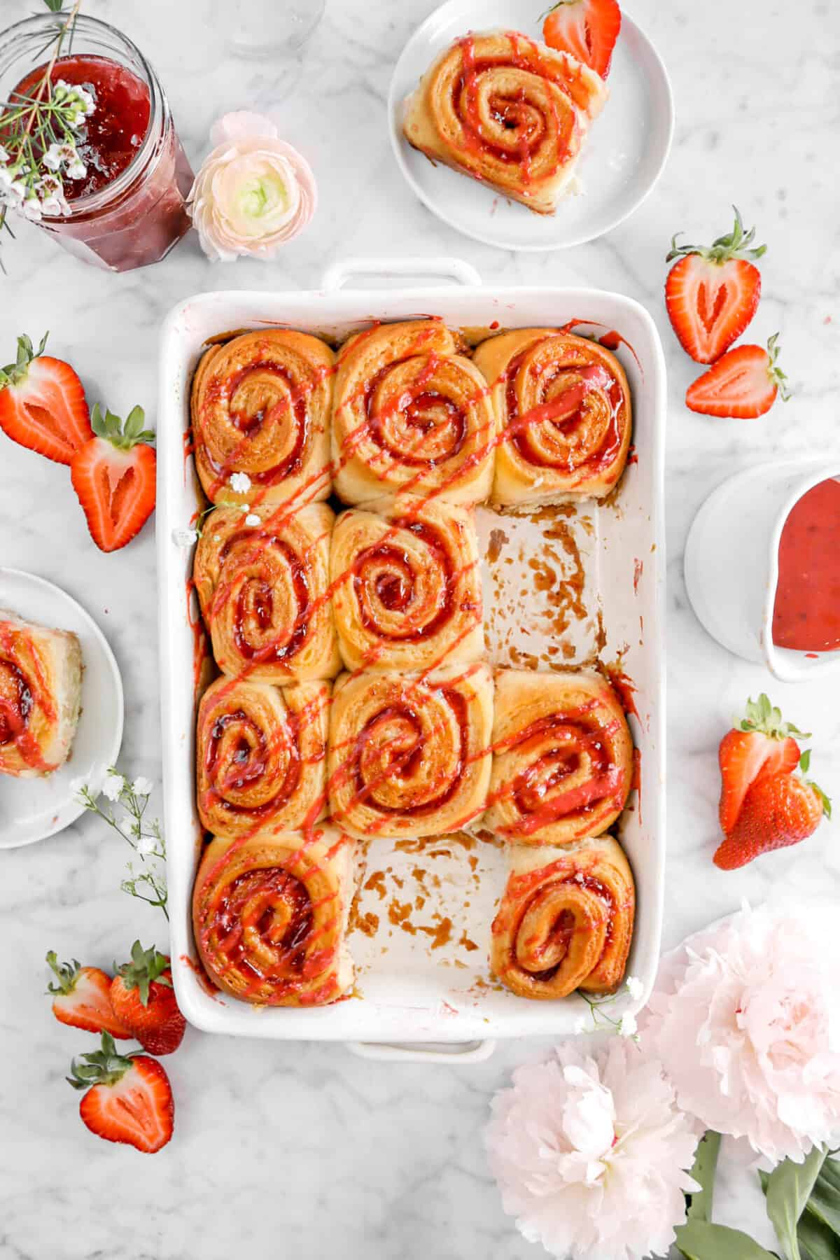 overhead shot of strawberry rolls in pan with two rolls missing