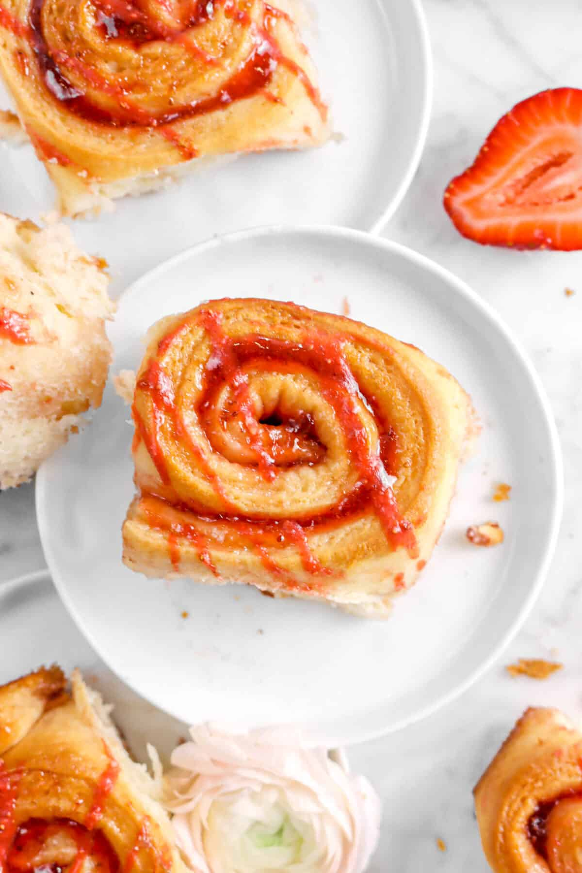 close up of strawberry roll on white plate